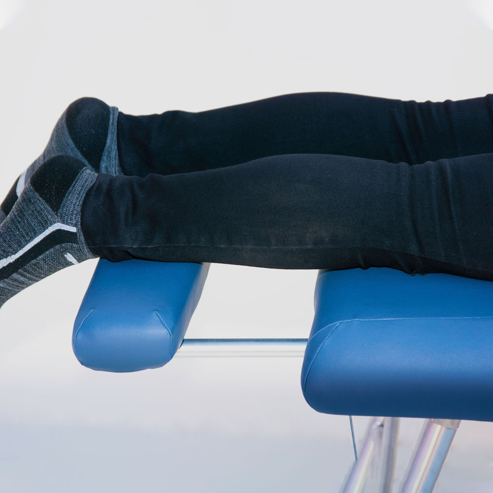 chiropractic table foot support extender in use