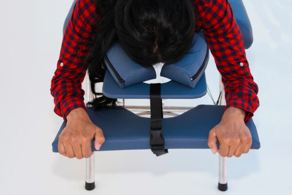 chiropractic table arm rest in use